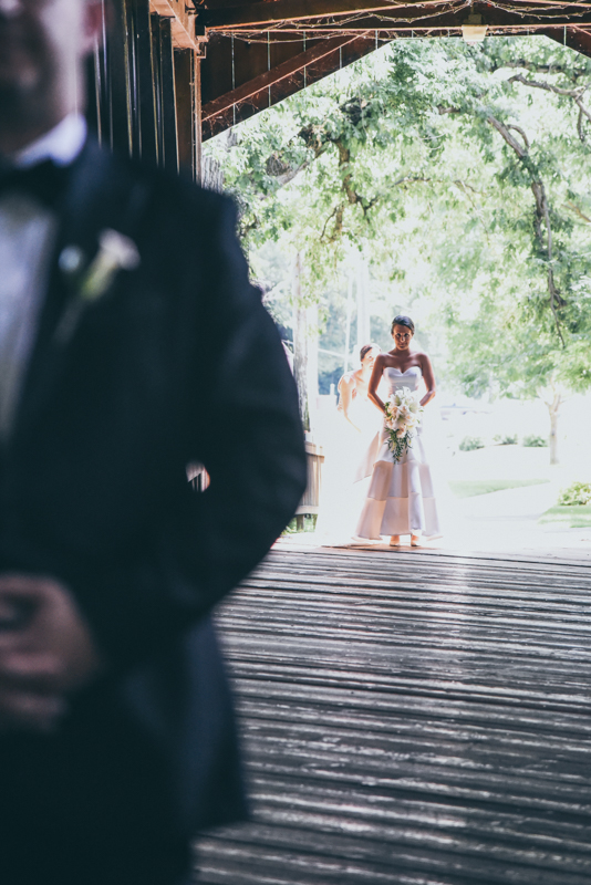 groom waiting for bride during first look