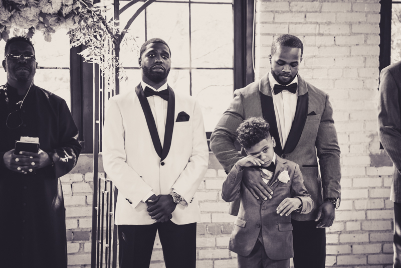 groom and his son waiting at the altar for the bride