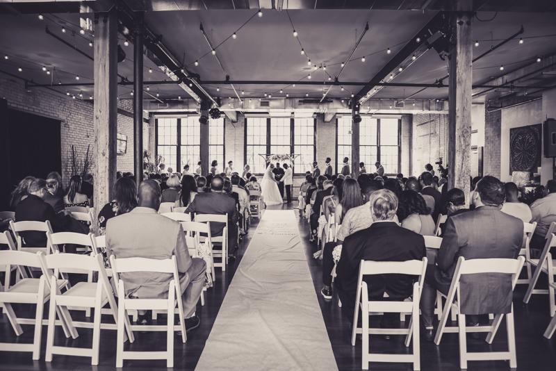 wide shot of a wedding at a loft venue