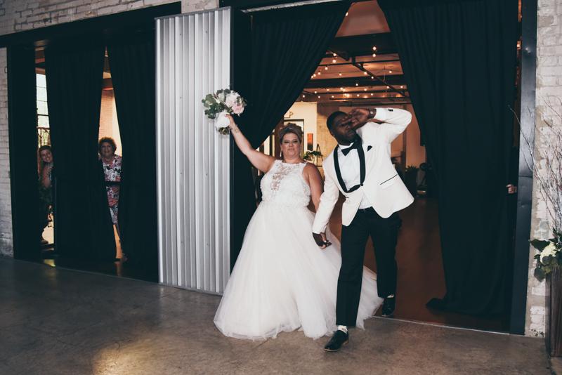 bride and groom's grand entrance into wedding reception
