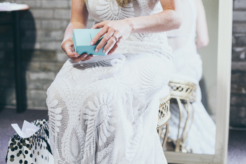 bride reading letters and getting gifts from groom