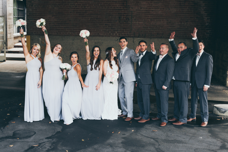 bridal party in an industrial building
