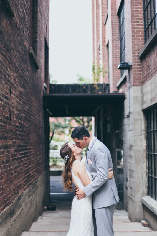 Bbridal party photos in a rustic loading dock area