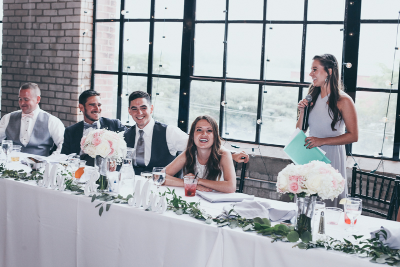 city view reception with pink and floral decor