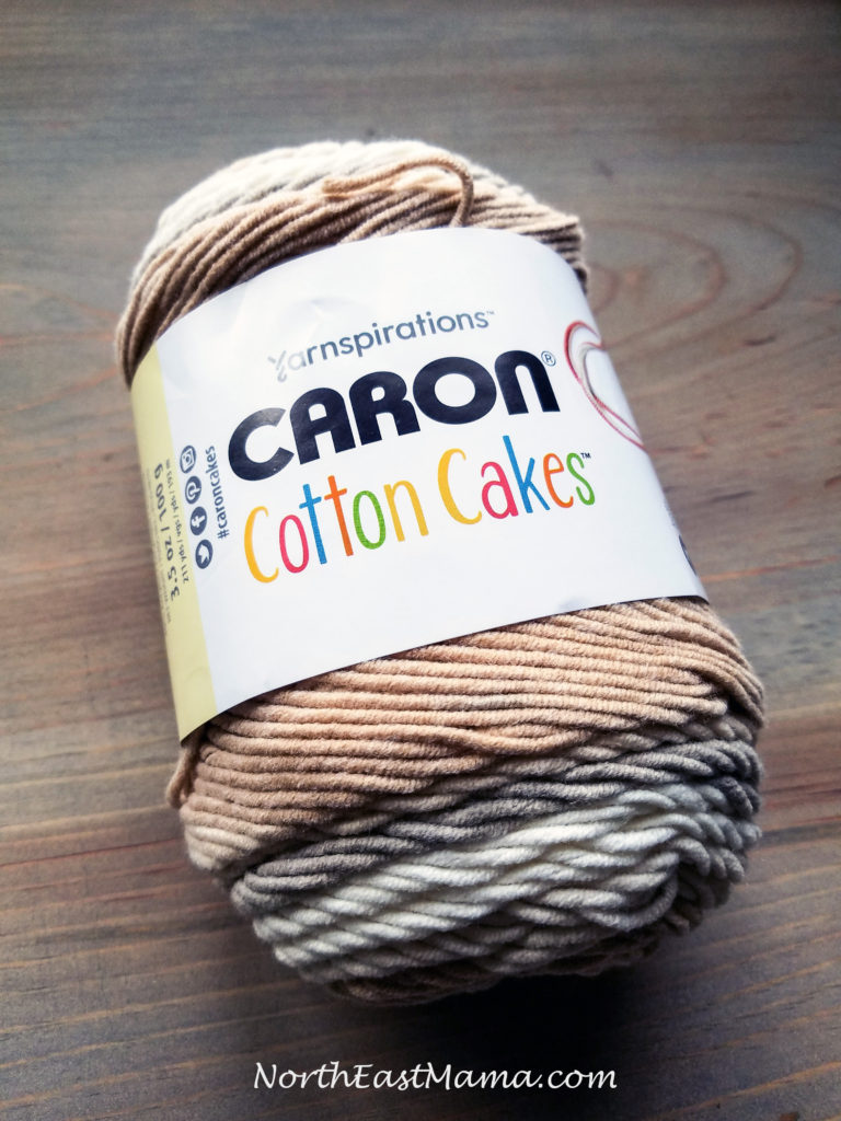 Image of 1 skein of Caron Cotton Cakes in Garden Path on a wood table