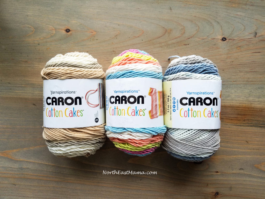 Image of 3 skein of Caron Cotton Cakes Left to Right: Garden Path, Garden Oasis, Nested Blues.