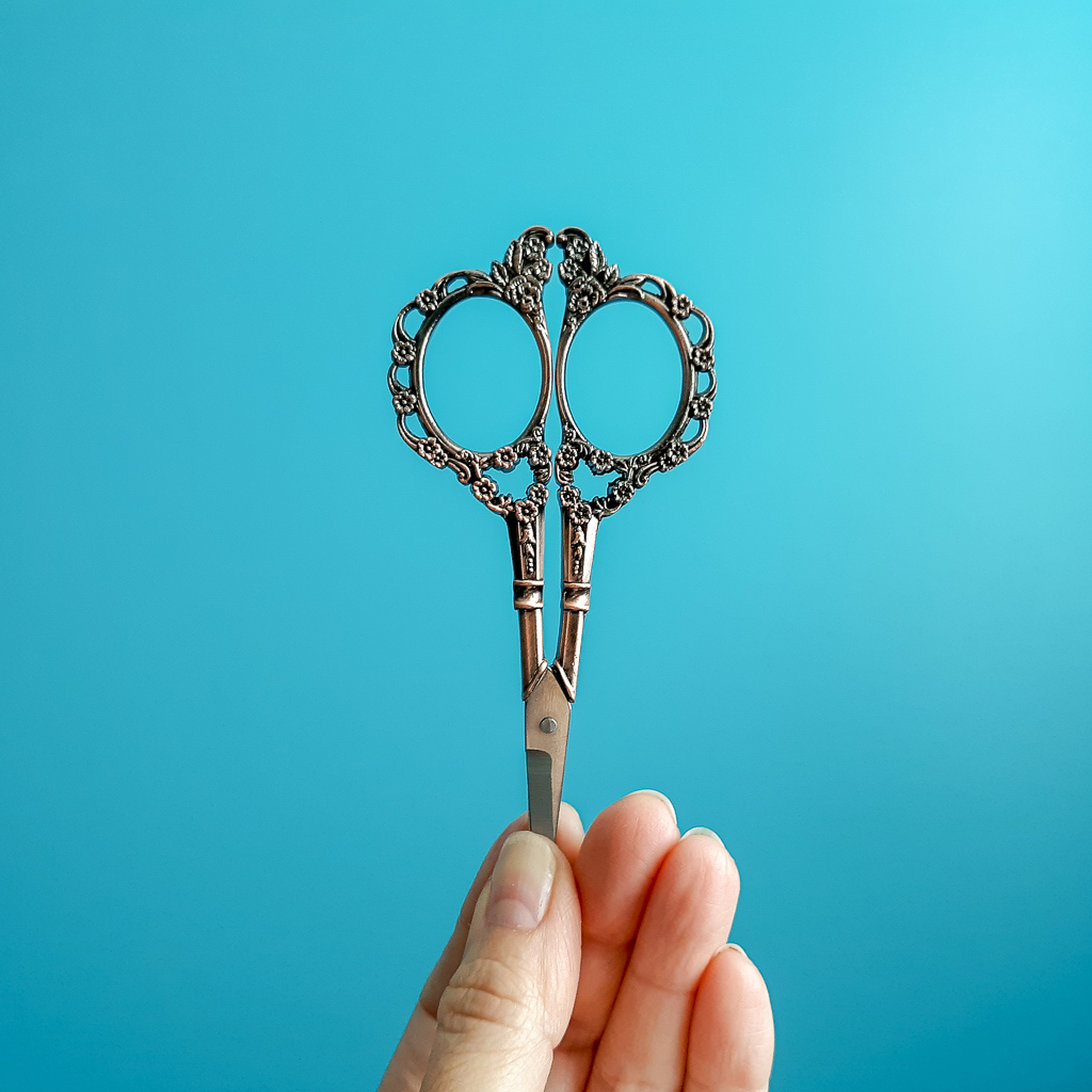 Image of a hand holding scissors