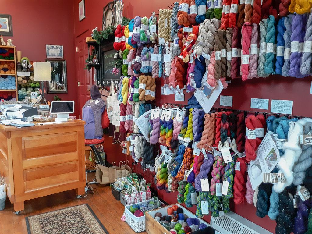 Colorful yarn displayed on wall