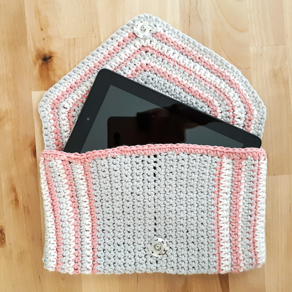 chic crochet clutch shown with tablet