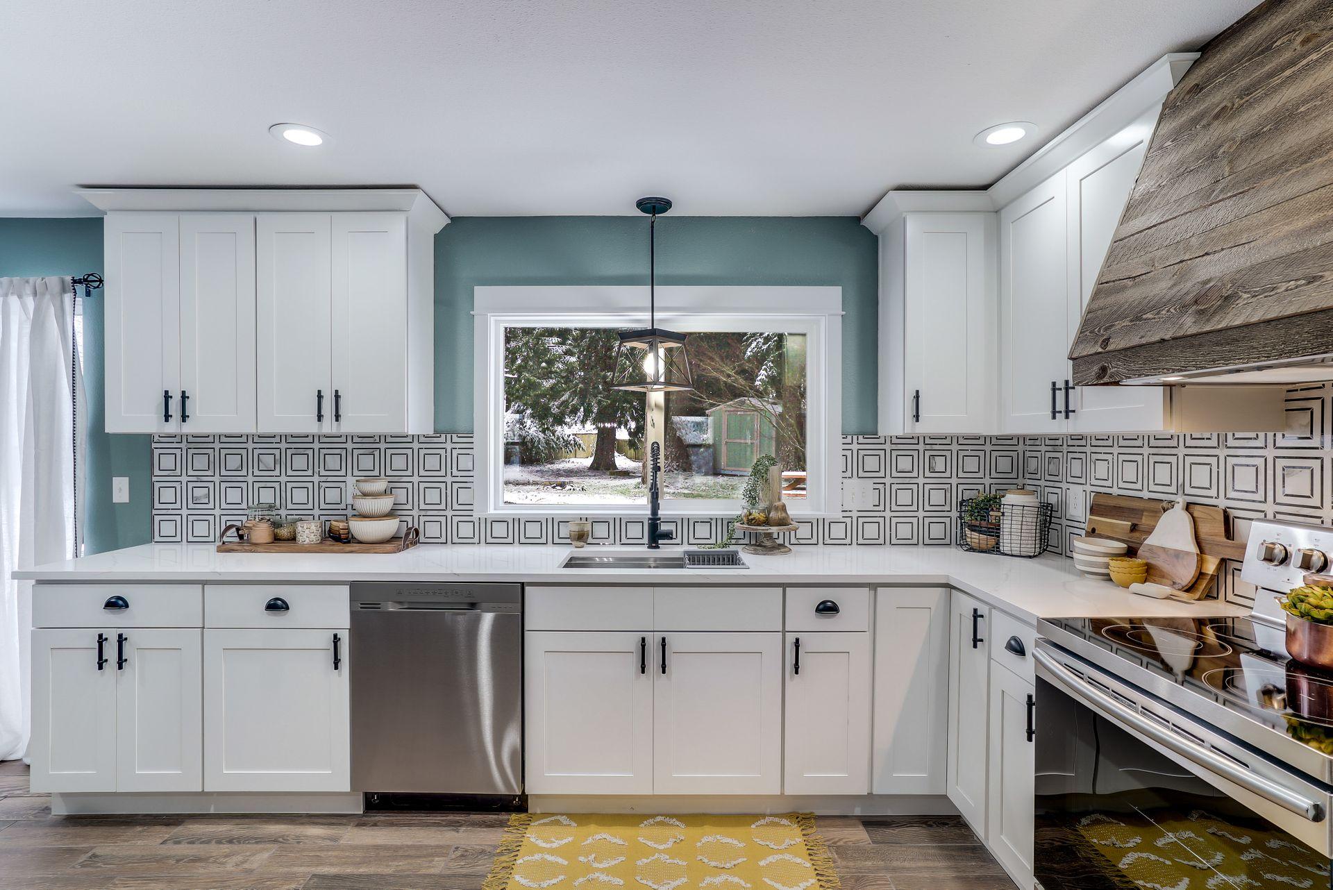 Elongated hexagon tile kitchen backsplash installed by professional tilers.