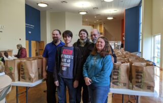 CAP Annual Holiday Sharing Program providing holiday turkey dinners to needy families