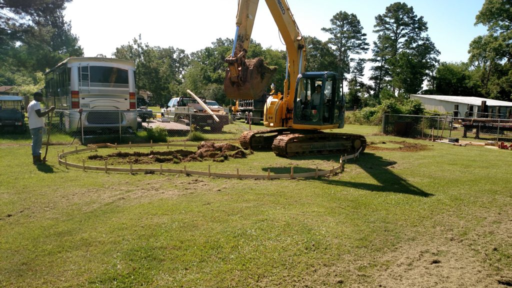 breaking ground on a new pool excavation