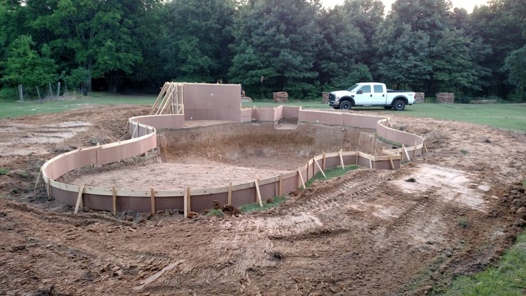 excavation complete and forms set on a free form pool
