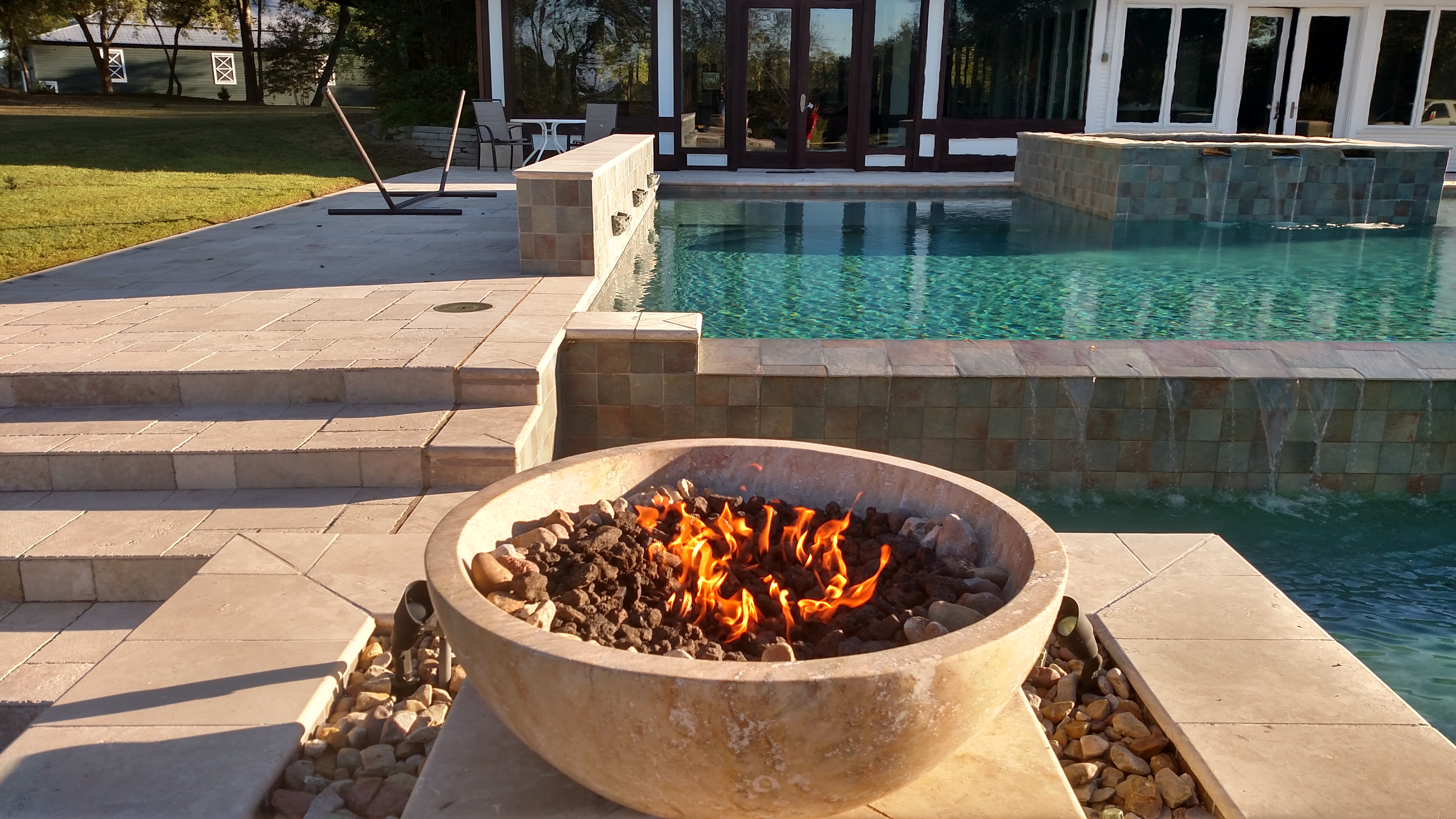 fire bowl next to pool