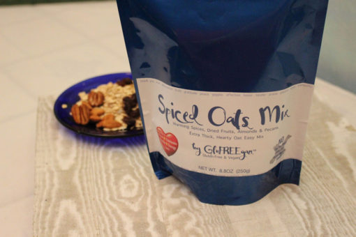 close up of blue bag of gluten free and vegan spiced oats mix with small blue plate of oat mix in the background