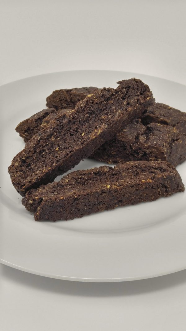 Gluten free and vegan chocolate biscotti on a white plate.