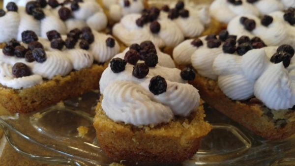 Gluten free and vegan cherry vanilla eclair cakes on a glass serving dish