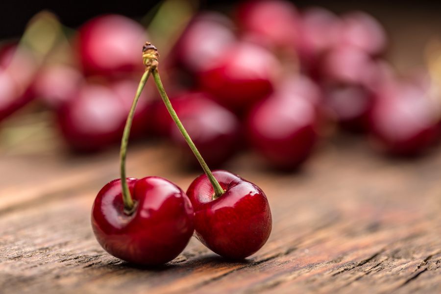 Ripe sour cherry berries on wooden board