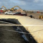 Grand Isle Hurricane Protection Project, installing geotextile tubes on beach