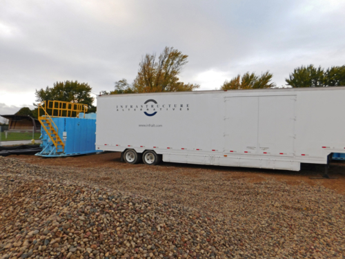 Mobile Water Treatment System staged near the dredged material stockpile