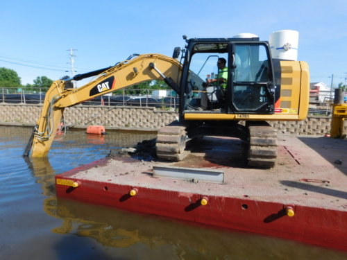 Debris removal operations in the canal