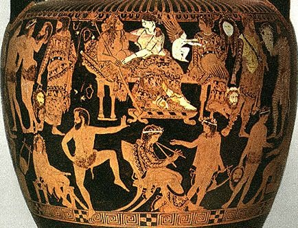 A vase from 5th Century Greece shows actors wearing elaborate costumes and holding masks. Via apgrd.uk