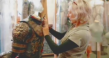 Award-winning costume designer Michele Clapton making adjustments to armor from Game of Thrones. Via HBO.