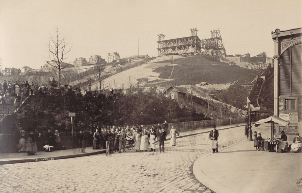 Mills at Montmartre by Georges Michel from the early 19th century shows Montmartre's humble beginnings. Via wikicommons.