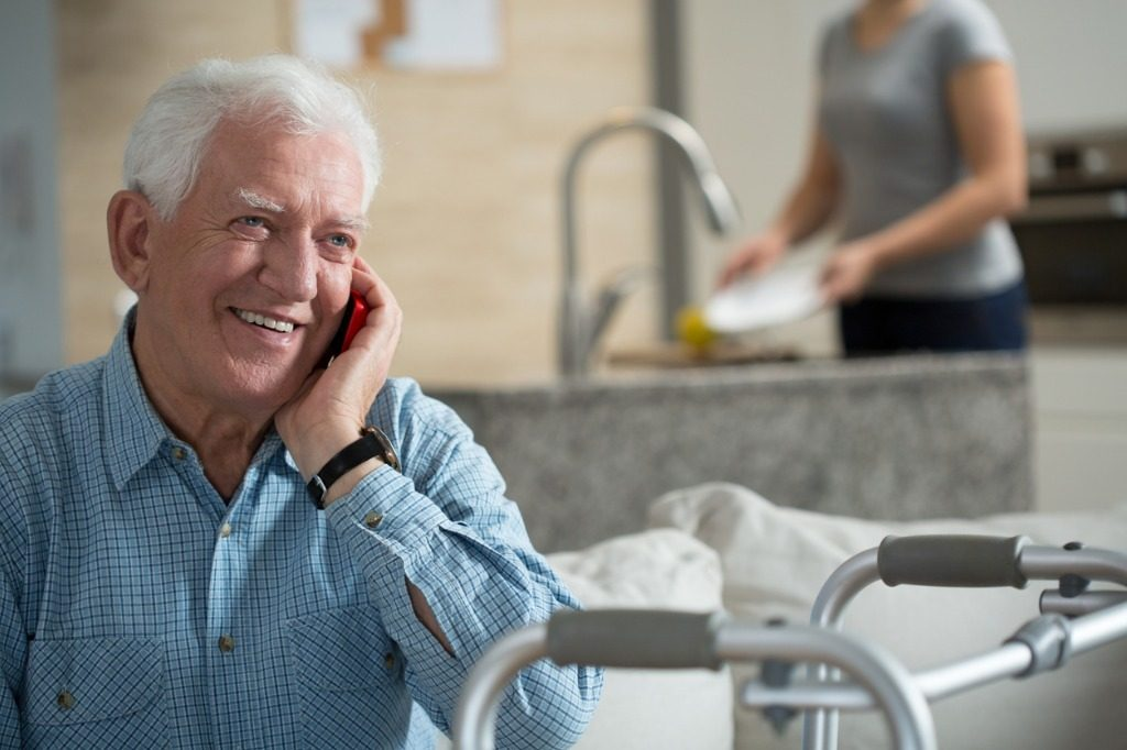 Elderly man calling the RN that oversee his home care.