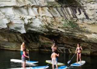 New River Gorge Cabins paddle boarding