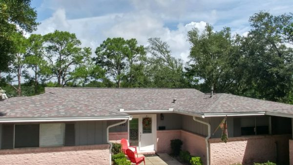 Image of a home roofed with Duration Colonial Slate shingles by Taylor Enterprises Inc.