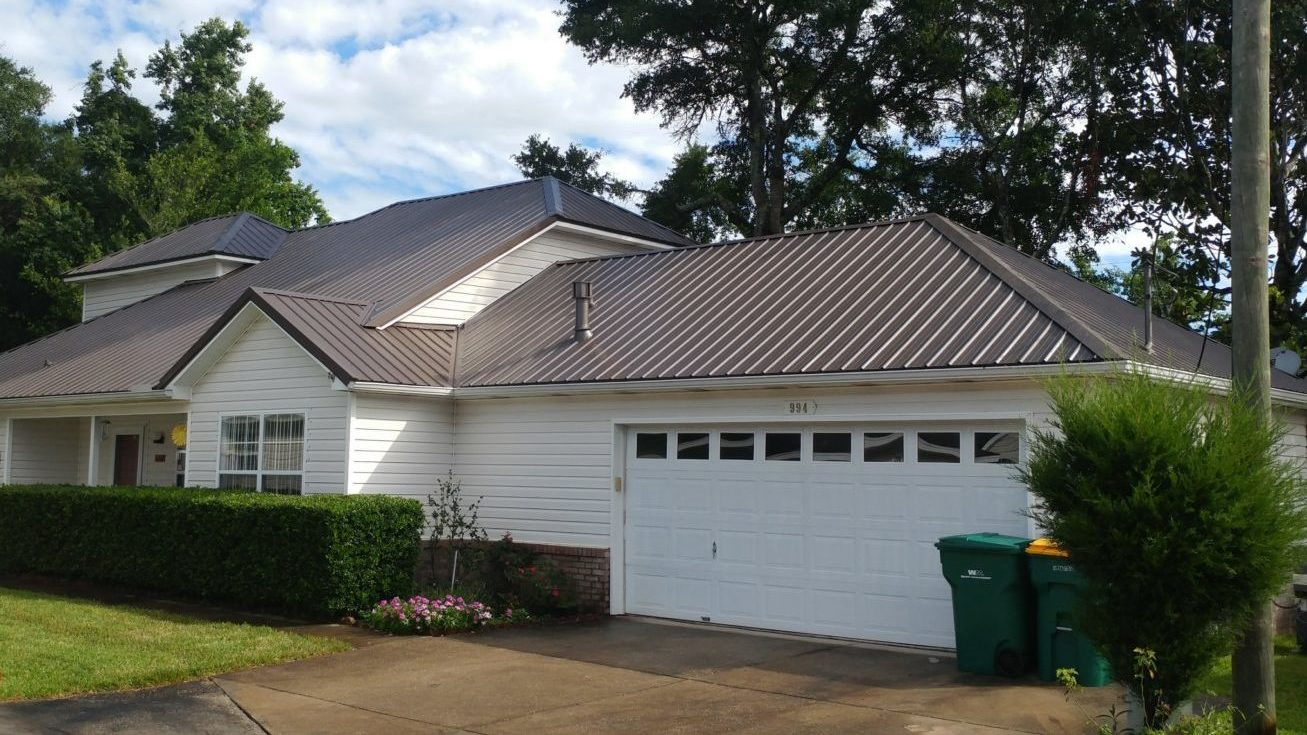Image of a home with Metal Roof Antique Bronze by Taylor Enterprises Inc.