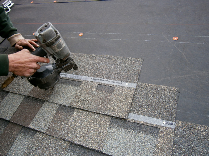 Image of a roof being shingled