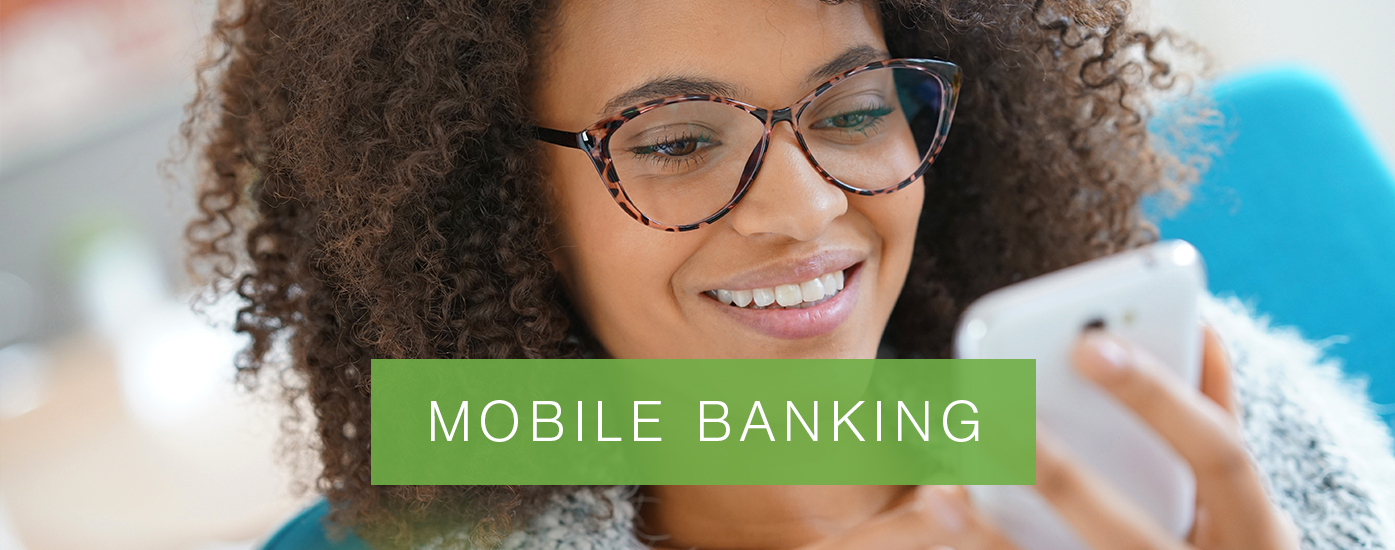"""Lady with glasses reading off of cell phone with banner that reads, """"Mobile Banking"""""""