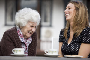woman and senior laughing