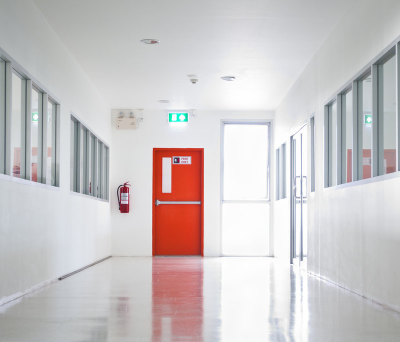 why do commercial buildings require fire doors