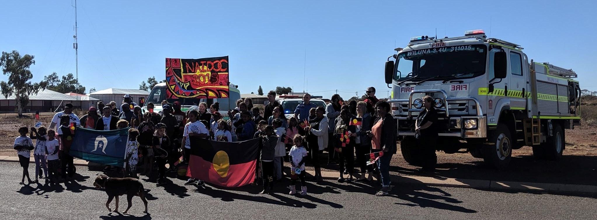Wiluna Volunteer Bush Fire Brigade 3.4U escorting the Wiluna Remote Community School on a march for NAIDOC Week 2019. Photo Facebook