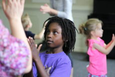 young child learning rhythm