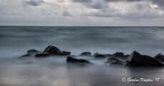 Image of rocks in surf at twilight