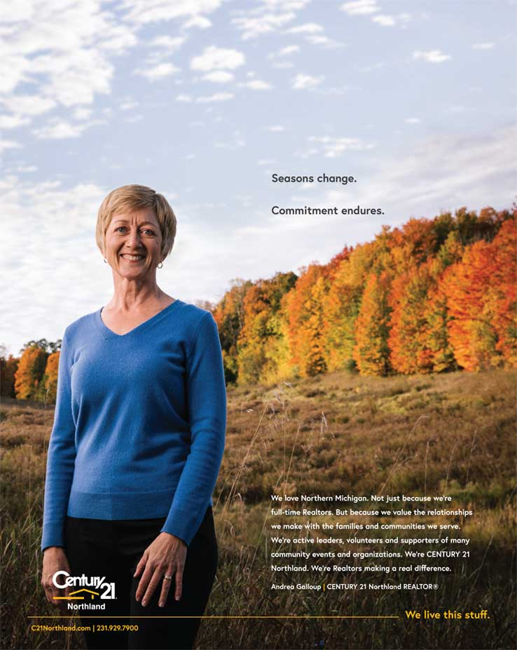 Woman with fall scenery in background