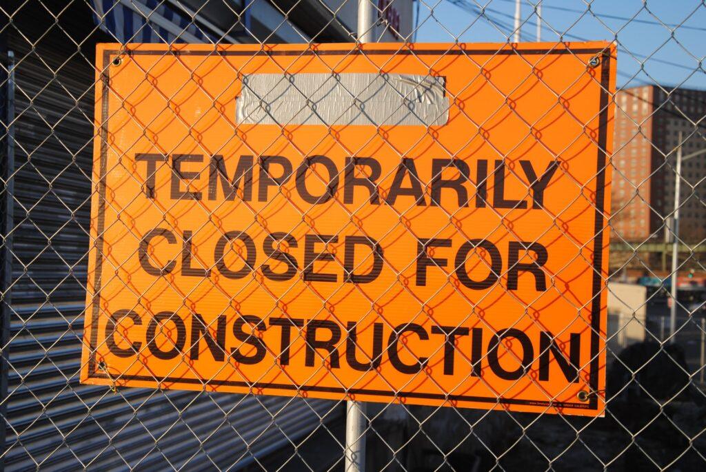 orange sign, construction, chainlink fence