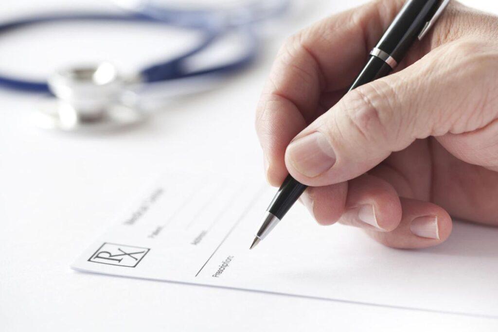 Doctor, prescription pad, pen, stethescope
