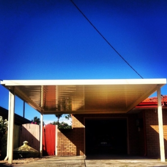 Conventional flat carport with high gloss c-deck