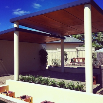 Two interlinked flat patios lined with stained marine ply