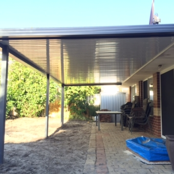 Conventional 'flat' patio clad with very high gloss C deck, large span, no internal beams
