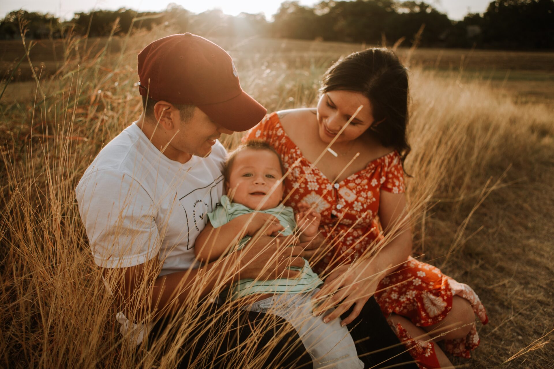 US immigration helped this happy family in long grass at sunset.