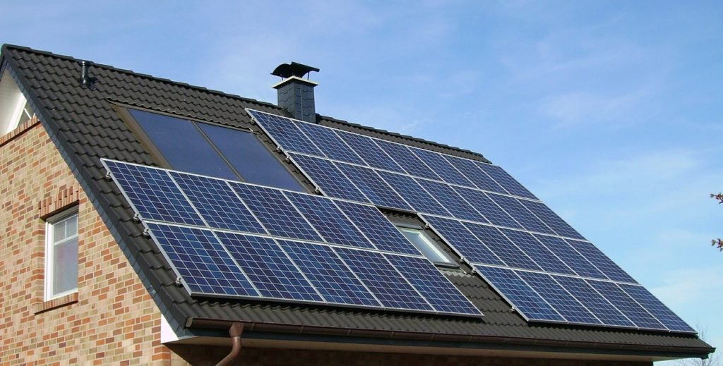 A photo of solar panels on a roof.