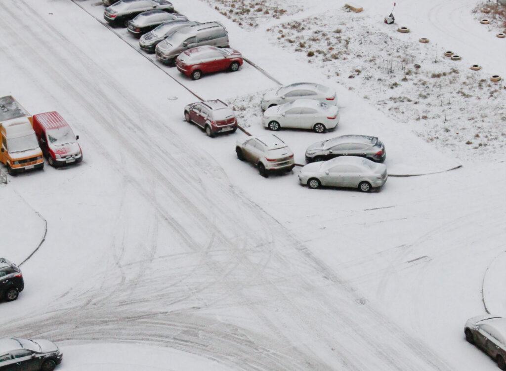 cars in snowy lot