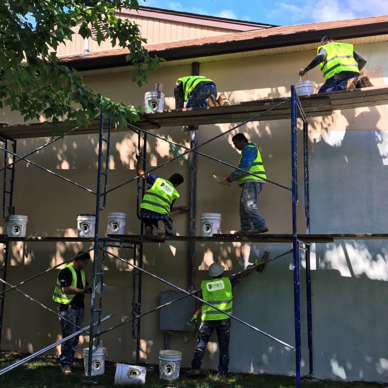 men_working_on_wall