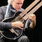 John Doan with Brunner Harp Guitar on stage in concert